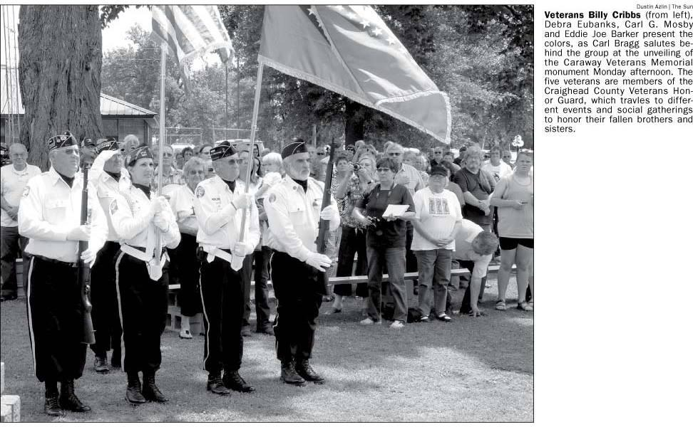 Newspaper article snippet: Veterans present the colors at Caraway Veterans Monument unveiling
