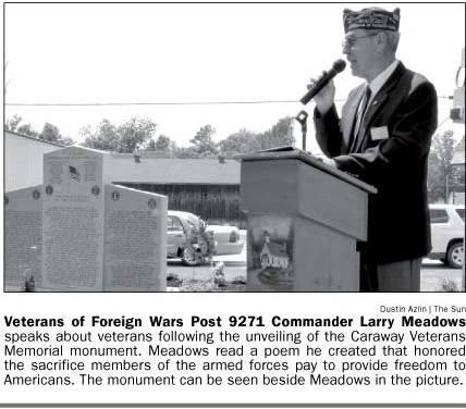Newspaper snippet: Veterans of Foreign Wars Post 9271 Commander Larry Meadows speaks at Veterans Monument unveiling